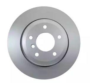 Перфорированный тормозной диск на БМВ 6 'HELLA PAGID 8DD 355 109-941'.